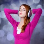 Redhead girl with headphones. — Stock Photo