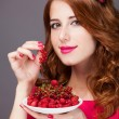 Redhead women with berries — Stock Photo