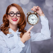 Redhead women with clock. — Foto de Stock