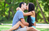 Young teen couple kissing at outdoor — Stock Photo