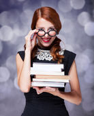 Smiling girl with books — Stock Photo