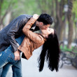 Couple kissing at alley in city. — Stock Photo #28078359