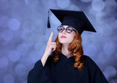 Graduating student girl in an academic gown. — Stock Photo