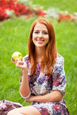 Girl with apple at outdoor — Stock Photo