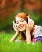 Girl with headphones at outdoor — Stock Photo
