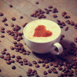 Cup with coffee and shape of the cacao heart on it. — Lizenzfreies Foto