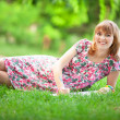 Stock Photo: Young beautiful pregnant womin park
