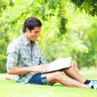 Young student with note at outdoor — Foto Stock