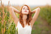 Redhead girl in corn field — Foto de Stock