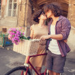 Couple with bike near house. — Stock Photo #29382263