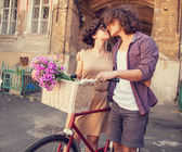 Couple with bike near house. — Stockfoto