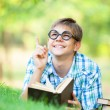 Teen boy with books in the park. — Foto Stock