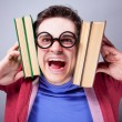 Stock Photo: Crazy student with books.
