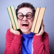 Crazy student with books. — Stock Photo