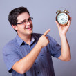 Stock Photo: Man holding big clock