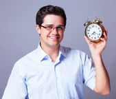Man holding big clock — Stock Photo