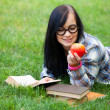 Teen girl with apple in the park. — Stock Photo