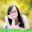 Teen girl with notebook in the park. — Stock Photo