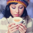 Redhead girl with red coffee cup. — Stock Photo