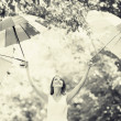 Girl with three umbrellas at outdoor — Stock Photo