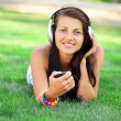 Brunette girl with headphones at outdoor — Foto Stock