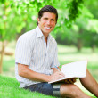 Young student with note at outdoor — Stockfoto
