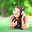 Brunette girl with headphones at outdoor — Stock Photo