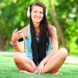 Brunette girl with headphones at outdoor — Stock Photo #30507383