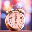 Stock Photo: Retro clock with bokeh at background