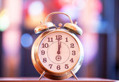 Retro clock with bokeh at background — Stock Photo