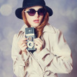 Stock Photo: Redhead girl in cloak with cameras spy