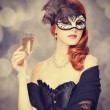 Redhead women in mask with champagne — Stock Photo
