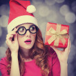 Redhead girl in christmas hat with gift. — Stok fotoğraf