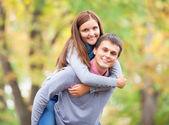 Teen couple at autumn park — Stock Photo