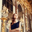 Beautiful women in mirror's hall of Versailles Chateau. France — Stock Photo