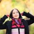 Brunette girl at autumn alley in the park — Stock Photo