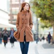Redhead women walking on the street — Stock Photo