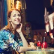 Beautiful redhead women sitting in cafe in Paris — Stock Photo