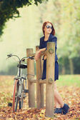 Beautiful redhead women with bike in Versailles gardens. France — Stock Photo