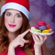 Redhead girl with macaron for Christmas — Stock Photo