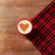 Stock Photo: Cup of coffee with tartan