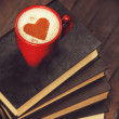 Cup of coffee with books — Stock Photo #33218473