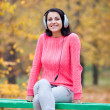 Portrait of a woman at outdoor with headphones. — Stock Photo #33391359