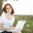 Young Businesswomen in white with glasses and laptop sitting nea — Stock Photo #3464985
