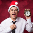 Handsome man with clock. — Stock Photo #34663979