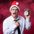 Stock Photo: Handsome man with clock.