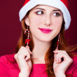 Stock Photo: Womportrait with christmas earnings