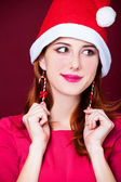 Woman portrait with christmas earnings — Photo