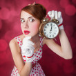 Beautiful redhead women with clock. — Stock Photo