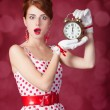 Beautiful redhead women with clock. — Zdjęcie stockowe
